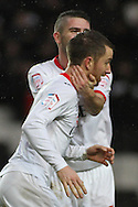 Picture by David Horn/Focus Images Ltd +44 7545 970036.26/12/2012.Dean Bowditch (front) of Milton Keynes Dons celebrates scroring with team mate Ryan Lowe (behind) during the npower League 1 match at stadium:mk, Milton Keynes.