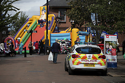 UK ENGLAND ROTHERHAM 28AUG14 - A police car guards a children's bouncy castle in the town centre of Rotherham, epicentre of the largest child sex abuse scandal in Britain.<br /> <br /> An August 2014 report found that around 1,400 children had been sexually exploited in the town between 1997 and 2013, mainly by British-Pakistani men.<br /> <br /> jre/Photo by Jiri Rezac<br /> <br /> &Acirc;&copy; Jiri Rezac 2014