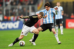 03.03.2010, Allianz Arena Muenchen, Muenchen, GER,  Laenderspiel Deutschland ( GER ) - Argentinien ( ARG ) im Bild  Bastian Schweinsteiger ( GER /  Bayern #07) - Lionel Messi ( ARG #10). EXPA Pictures © 2010, PhotoCredit: EXPA/ nph/  Kurth / for Slovenia SPORTIDA PHOTO AGENCY.