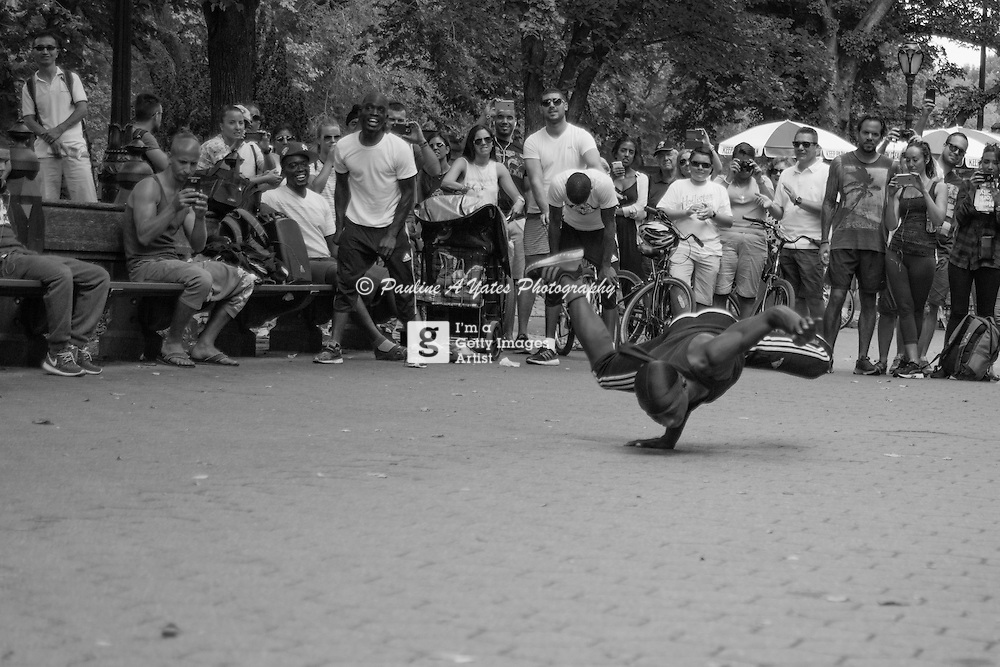 Street performers 2 Steps Away perform in Central Park, NYC