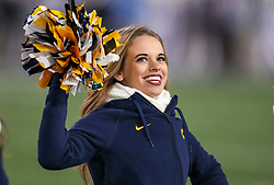 Oct 25, 2018; Morgantown, WV, USA; A West Virginia Mountaineers cheerleader performs during the third quarter against the Baylor Bears at Mountaineer Field at Milan Puskar Stadium. Mandatory Credit: Ben Queen-USA TODAY Sports