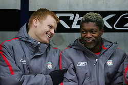 BOLTON, ENGLAND - MONDAY, JANUARY 2nd, 2006: Liverpool's John Arne Riise and Djibril Cisse share a joke during the Premiership match against Bolton Wanderers at the Reebok Stadium. (Pic by David Rawcliffe/Propaganda)