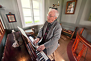 Skogar Folk Museum's director, Thordur Tomasson plays the organ inside the Church on site at<br /> this Museum along the Sutheast Coast of Iceland.
