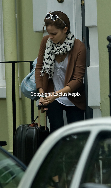 EXCLUSIVE PICTURE<br /> 07/09/2011<br /> Emma Watson Leaves Her London home with a suitcase. On route to Heathrow airport.<br /> &copy;Gareth Connely/Exclusivepix