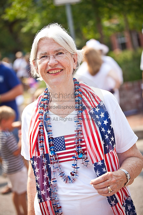 An elderly woman dressed in patriotic costume in the I'On Community 4th of July parade.