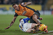 Abel Hernández (Hull City) is tackled by Aiden McGeady (Sheffield Wednesday) who gives away a throw-in during the Sky Bet Championship match between Hull City and Sheffield Wednesday at the KC Stadium, Kingston upon Hull, England on 26 February 2016. Photo by Mark P Doherty.