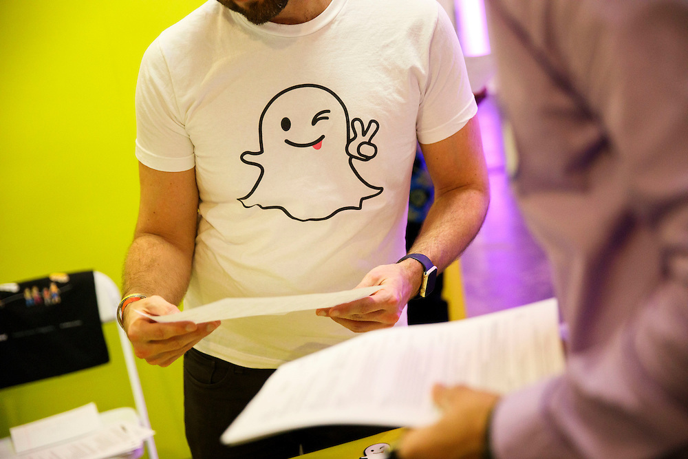The Snapchat ghost logo is displayed on a shirt during the TechFair LA job fair in Los Angeles, California, U.S., on Thursday, January 26, 2017. Snap Inc., parent company of the Snapchat app has filed documents for an initial public offering (IPO) with the Securities and Exchange Commission (SEC). © 2017 Patrick T. Fallon