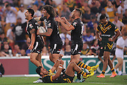 BRISBANE, AUSTRALIA - OCTOBER 25:  Shaun Johnson of New Zealand celebrates scoring a try with team mates during the Four Nations Rugby League match between the Australian Kangaroos and New Zealand Kiwis at Suncorp Stadium on October 25, 2014 in Brisbane, Australia.  (Photo by Matt Roberts/Getty Images)