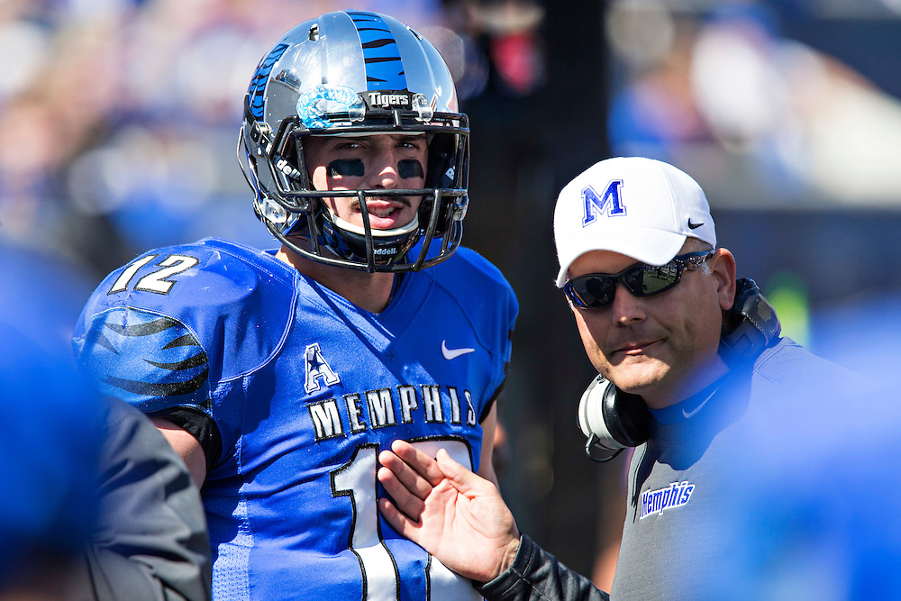 MEMPHIS, TN - OCTOBER 17:  Head Coach Justin Fuente talks with Paxton Lynch #12 of the Memphis Tigers during a game against the Ole Miss Rebels at Liberty Bowl Memorial Stadium on October 17, 2015 in Memphis, Tennessee.  The Tigers defeated the Rebels 37-24.  (Photo by Wesley Hitt/Getty Images) *** Local Caption *** Paxton Lynch; Justin Fuente