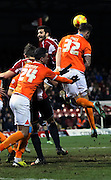 Grant Hall clearing header during the Sky Bet Championship match between Brentford and Blackpool at Griffin Park, London, England on 24 February 2015. Photo by Matthew Redman.
