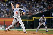 Apr 22, 2017; Phoenix, AZ, USA; Los Angeles Dodgers starting pitcher Kenta Maeda (18) delivers a pitch in the first inning against the Arizona Diamondbacks at Chase Field. Mandatory Credit: Jennifer Stewart-USA TODAY Sports