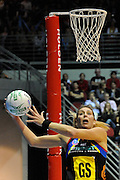 Irene Van Dyk makes a desperate grab late in the match during action from the Major Semi Final of the ANZ Netball Championship played between the Firebirds and the Magic at the Gold Coast Convention and Exhibition Centre on Monday 9th May 2011