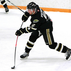 AURORA, ON - Feb 14 : Ontario Junior Hockey League Game Action between the Cobourg Cougars and the Aurora Tigers, Alex D'Oliveira #5 of the Cobourg Cougars Hockey Club shoots the puck from the blue line during first period game action.<br /> (Photo by Brian Watts / OJHL Images)