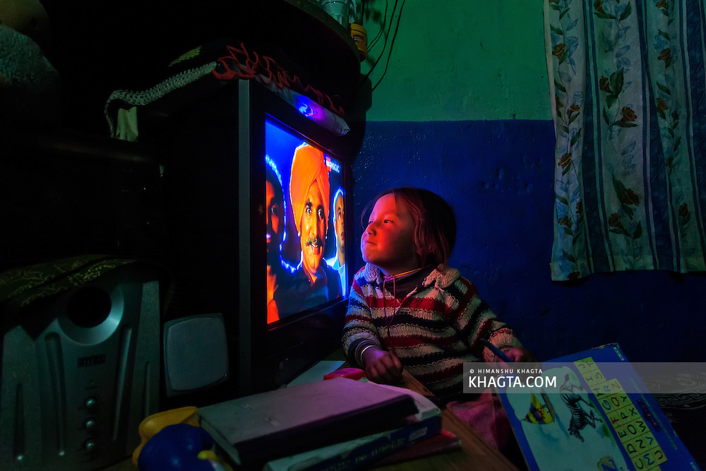 Tenzin imitating the character in the television at her home stay in Langza Village of Spiti.