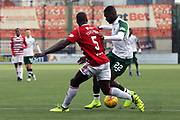 Hamilton Academical defender Delphin Tshiembe (5) tackles Glasgow Celtic forward Odsonne Edouard (22) during the Ladbrokes Scottish Premiership match between Hamilton Academical FC and Celtic at New Douglas Park, Hamilton, Scotland on 24 November 2018. Pic Mick Atkins