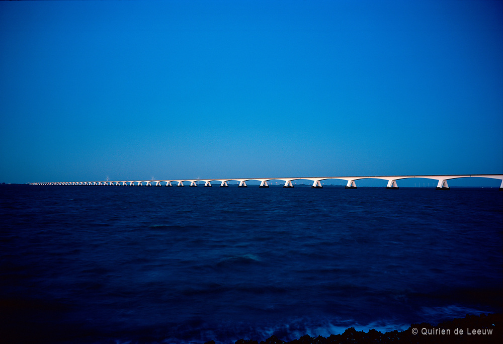 The Zeeland Bridge and Oosterschelde sea at late evening. The bridge is the longest bridge in the Netherlands with a length of 5km. It connects two Islands in Zeeland province.