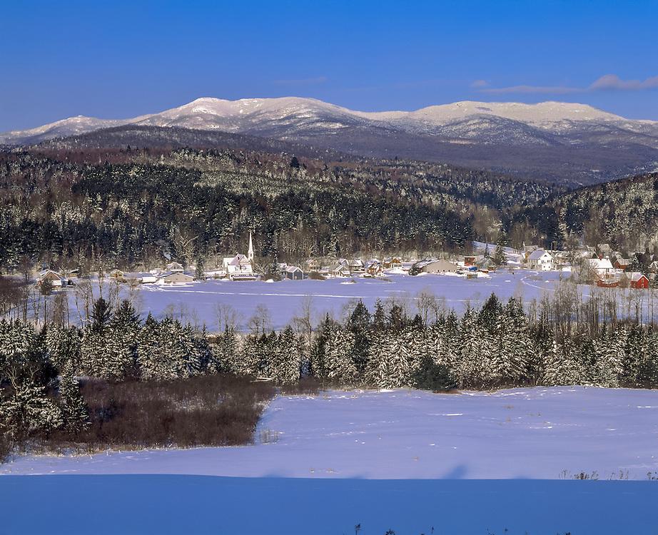 Village nestled in valley below Worcester Mtns after snow, Worcester, VT