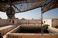 Morocco, Marrakech. rooftops and the minaret of the medersa Ben Youssef,  view from SAPHO ryad, in the medina, old city /   Marrakech/  les toits et le minaret de  la medersa BEn Youssef vue depuis le Ryad de SAPHO dans la Medina, dans la vielle ville