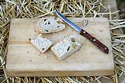 cut bread on wooden board