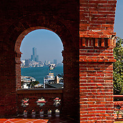 Kaohsiung's tallest building, the Tuntex Building, is framed in the Brick archways of the Former British Consulate residence, Kaohsiung City, Taiwan