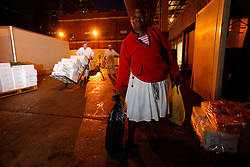 UK ENGLAND LONDON 19AUG11 - Jaimaican-born Beverley Wiilson (55) carries bags of fresh fish at the Billingsgate Fish Market at 5 a.m. in the morning in east London...jre/Photo by Jiri Rezac..© Jiri Rezac 2011