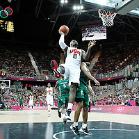 02 August 2012: USA LeBron James goes for the jumpshot over Nigeria Derrick Obasohan during 156-73 Team USA victory over Team Nigeria, during the men's basketball preliminary, at the Basketball Arena, in London, Great Britain.