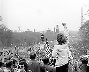 A demonstrator raises a clenched fist toward antiwar protestors on the U.S. Capitol grounds and the Mall during massive demonstrations against the Vietnam war on April 23, 1971 as Lt. John Kerry prepares to speak. - To license this image, click on the shopping cart below -
