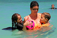Mother with children at Guadalavaca, Holguin, Cuba.