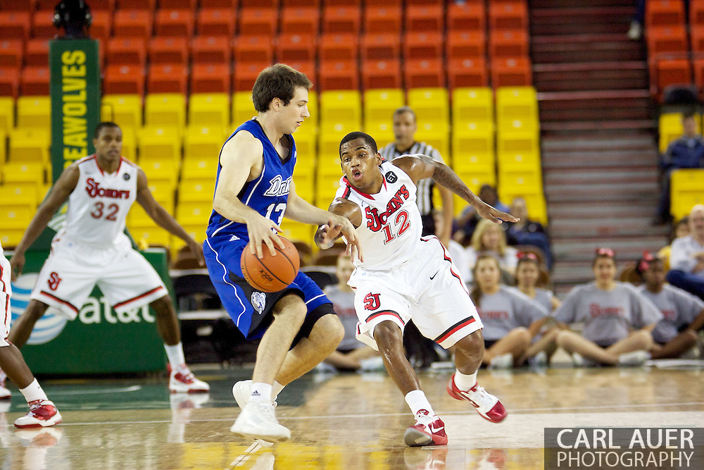 November 26th, 2010:  Anchorage, Alaska - St. John's senior guard Dwight Hardy (12) tries to poke the ball away in the Red Storm's semi final game of the Great Alaska Shootout against the Drake Bulldogs.  The Red Storm defense held Drake to a tournament low score as St. Johns advanced to the final game 82-39.