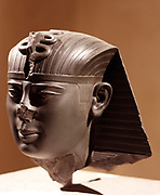 Head of a statue of King Amasis , 26 Dynasty, around 550 BC Saix greywacke