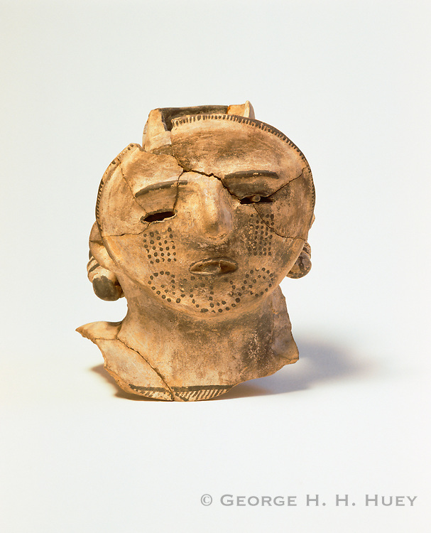 0204-1040 ~ Copyright: George H. H. Huey ~ Stylized human head from an effigy pottery vessel, found at Pueblo Bonito. Chaco Culture National Historical Park, New Mexico.