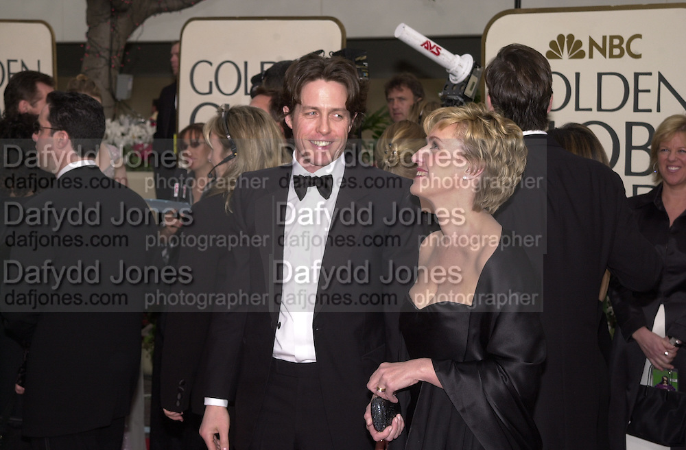 Tina Brown and Hugh Grant. Golden Globes. Beverley Hilton. 21 January 2001. © Copyright Photograph by Dafydd Jones 66 Stockwell Park Rd. London SW9 0DA Tel 020 7733 0108 www.dafjones.com