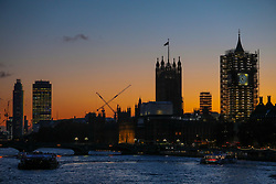 © Licensed to London News Pictures. 18/11/2019. London, UK. Sunset over the Thames towards the Houses of Parliament and Vauxhall Cross as the Met Office issue a yellow weather warning for freezing fog with disruption to transport tomorrow as temperatures are set to tumble to -2 in the London area . Photo credit: Alex Lentati/LNP