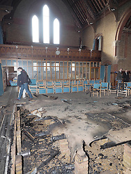 View of the interior of the Derby Road Baptist church, Watford, after an arson attack Saturday Feb.1, 2014, United Kingdom. Photo taken Sunday, 2nd February 2014. Picture by Max Nash / i-Images