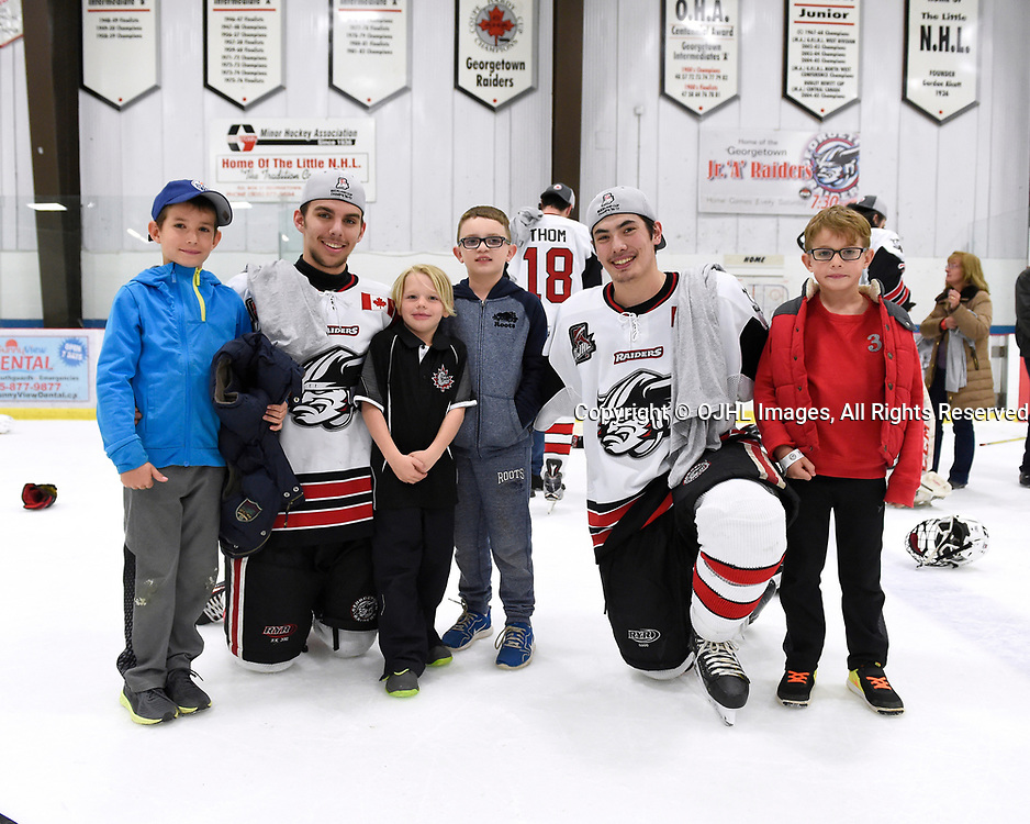 GEORGETOWN, ON - APR 26,  2017: Ontario Junior Hockey League, Championship Series. Georgetown Raiders vs the Trenton Golden Hawks in Game 7 of the Buckland Cup Final.  Josh Dickinson #28 and Austin Cho #20 with future Georgetown Raiders teammates.<br /> (Photo by Andy Corneau / OJHL Images)