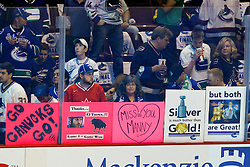 June 4, 2011; Vancouver, BC, CANADA; Vancouver Canucks fans hold up signs in support of center Manny Malhotra (not pictured) and left wing Raffi Torres (not pictured) before game two of the 2011 Stanley Cup Finals against the Boston Bruins at Rogers Arena. Vancouver defeated Boston 3-2 in overtime. Mandatory Credit: Jason O. Watson / US PRESSWIRE