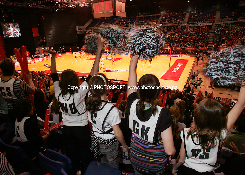 Fans wearing thier netball bibs watch the opening minutes of the game.<br /> New World International Netball Series, Silver Ferns v Australia, Westpac Arena, Christchurch, New Zealand, Wednesday 17 September 2008. Photo : PHOTOSPORT