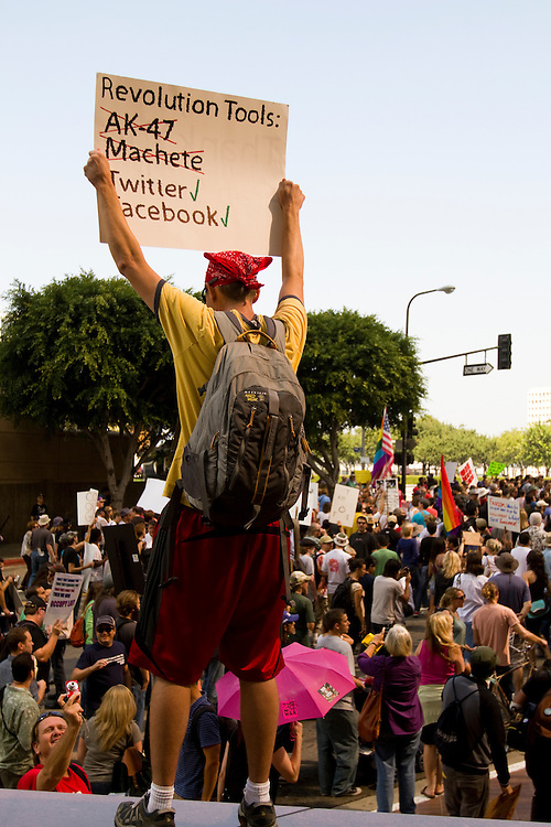 Occupy Los Angeles protesters participate in the global day of protest in demonstration against corporate greed by marching through the financial district.