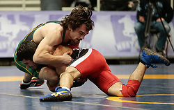 London, Ontario ---2013-03-02---   Jason Wass of  University Of Alberta takes on  Zack Falcioni of  Brock in the men's 57 KG bronze medal match at the 2012 CIS Wrestling Championships in London, Ontario, March 02, 2013. .GEOFF ROBINS/Mundo Sport Images