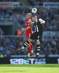 NEWCASTLE-UPON-TYNE, ENGLAND - Sunday, April 1, 2012: Liverpool's Jonjo Shelvey in action against Newcastle United's Danny Guthrie during the Premiership match at St James' Park. (Pic by David Rawcliffe/Propaganda)