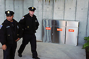 Police men walking past Trash and Compost and Recycle containers on opening day at California Academy of Sciences.The California Academy of Sciences is a world-class scientific and cultural institution based in San Francisco. The Academy recently opened a new facility in Golden Gate Park, a 400,000 square foot structure that houses an aquarium, a planetarium a natural history museum and a 4-story rainforest all under one roof. The new facility was built by renowned architect Renzo Piano...Alternative Energy in Silicon Valley and the San Francisco Bay Area