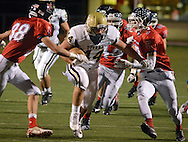 DOYLESTOWN, PA - OCTOBER 17: Truman's Hunt Trysten #44 runs with the football in the first quarter as Central Bucks East's Dustin Buchanan #38 and Tommy Strasburger #7 chase after him at War Memorial Stadium October 17, 2014 in Doylestown, Pennsylvania. (Photo by William Thomas Cain/Cain Images)