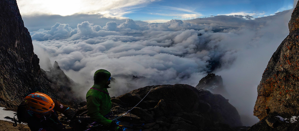 Pete McBride and Frank Pope brace themselves for another round of thunderstorms high on Batian, Mount Kenya.