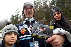 Primoz Peterka of Slovenia with his son Maj and wife Renata cheers for his frend Robert Kranjec when Primoz finishes his career during  1st day of FIS Ski Jumping World Cup Finals Planica 2011, on March 17, 2011, Planica, Slovenia. (Photo by Vid Ponikvar / Sportida)