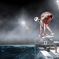 A swimmer in the starting position before a race.