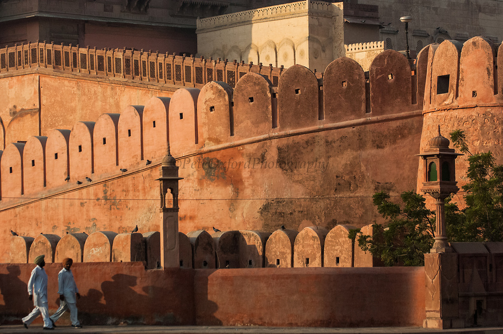 Junagarh Fort, Bikaner, Rajasthan, INDIA<br /> This fort is well preserved. Built in 1588 by Raja Rai Singh it is unusual in the sense that it was one of the few forts in Rajasthan not built on a hilltop but instead built on the desert plains. Beyond the main gate lies a complex of splendid palaces, each built by a different ruler over the centuries. <br /> Bikaner was founded in the 15th century by the son of the Rathor Raja of Marwar (Jodpur). Taking offence at a comment that his father had made he left with a band of horsemen to set up his own kingdom in the desert. Spurred on by the blessing of Karni Mata (whose rat temple is whorshipped by Hindus till today) he fought the local desert clans for 30 years, ultimately carving out a kingdom approx. the size of England. Today this town is still at heart a medieval walled desert town. The thick crenelated walls encircling it are still there studded with five huge gates that were once locked at night. It is a pink city as it is carved out of pink sand stone characteristic of this region.