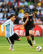 CAPE TOWN, SOUTH AFRICA- Saturday 3 July 2010, Carlos Tevez challenges Sami Khedira during the quarter final match between Argentina and Germany held at the Cape Town Stadium in Green Point during the 2010 FIFA World Cup..Photo by Roger Sedres/Image SA