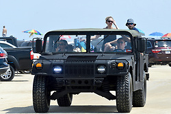 Beachgoers in a humvee ride over a parking lot near the beach at Chincoteague Island, Accomack County, Virginia, during Labor Day weekend on September 1, 2018. The American public holiday of Labor Day, on the first Monday in September is considered the unofficial  end of Summer.