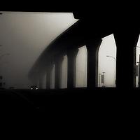 The silhouette of a bridge in mist