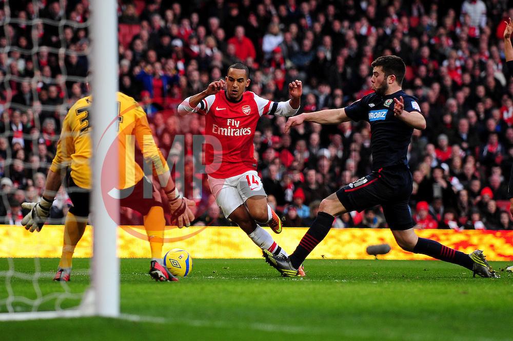 Arsenal's Theo Walcott is through on goal - Photo mandatory by-line: Dougie Allward/JMP - Tel: Mobile: 07966 386802 16/02/2013 - SPORT - FOOTBALL - Emirates Stadium - London -  Arsenal V Blackburn Rovers - FA Cup - Fifth Round
